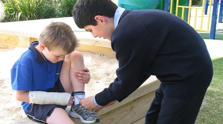 Boys Tying Shoe