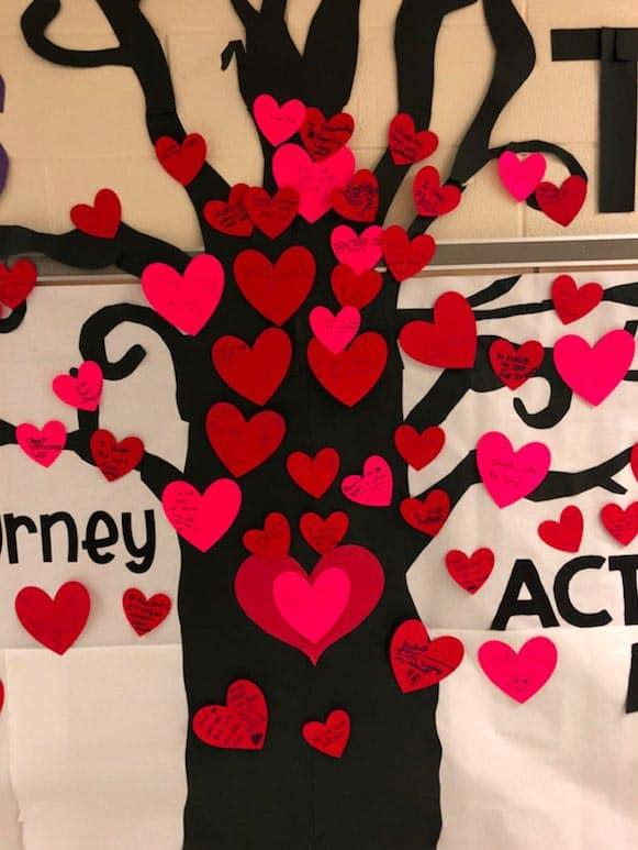 Good deeds written on hearts on JFK Elementary kindness tree.