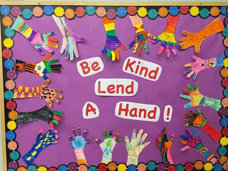 Be Kind Lend a Hand bulletin board by Del Mar Pines School