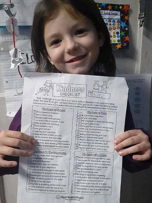 Girl Holding Her Kindness Checklist